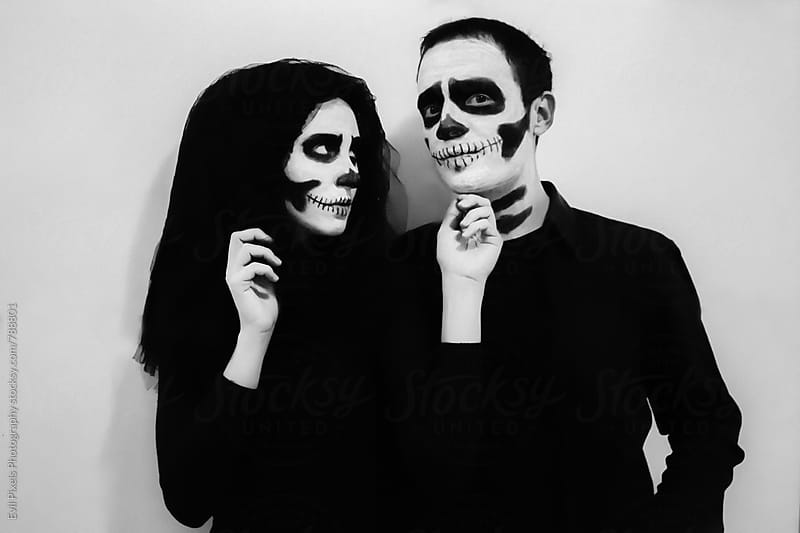 Young couple preparing for halloween by Branislava Živić for Stocksy United