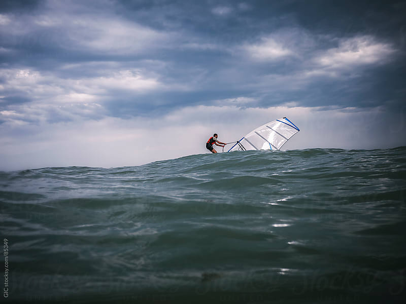 Man surfing on the waves by GIC for Stocksy United