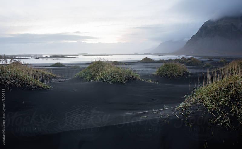 Dusk over black sand dunes in Stokksnes by Jonatan Hedberg for Stocksy United