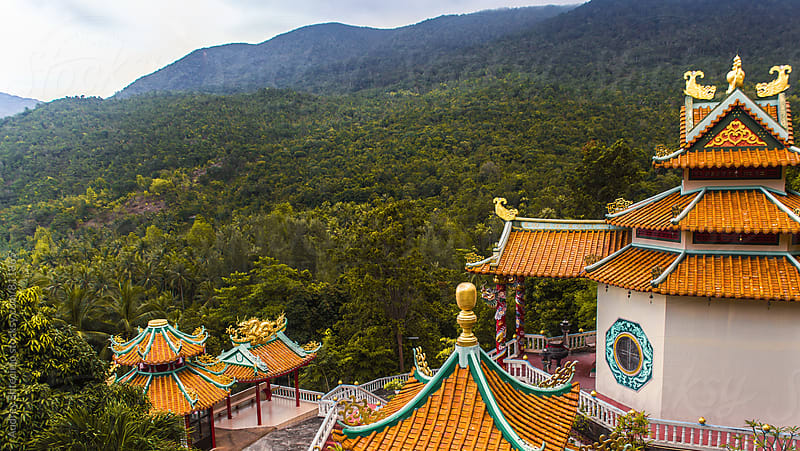 Chinese buddhist temple in the middle of jungle/ Temple of Buddha of compassion by Audrey Shtecinjo for Stocksy United