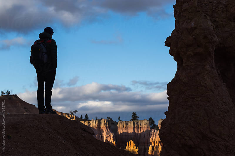 Man standing in front of the panorama of Bryce Canyon by michela ravasio for Stocksy United