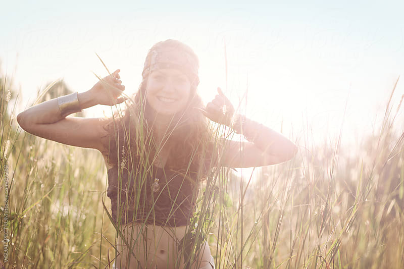 Young Female Hippie in Grass Meadow by Julien L. Balmer for Stocksy United