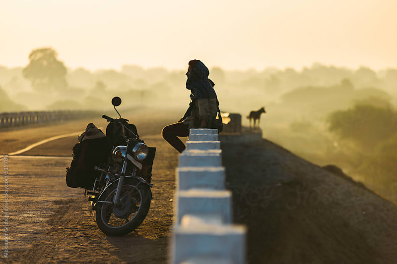 Woman With Motorbike On Road  by Alexander Grabchilev for Stocksy United
