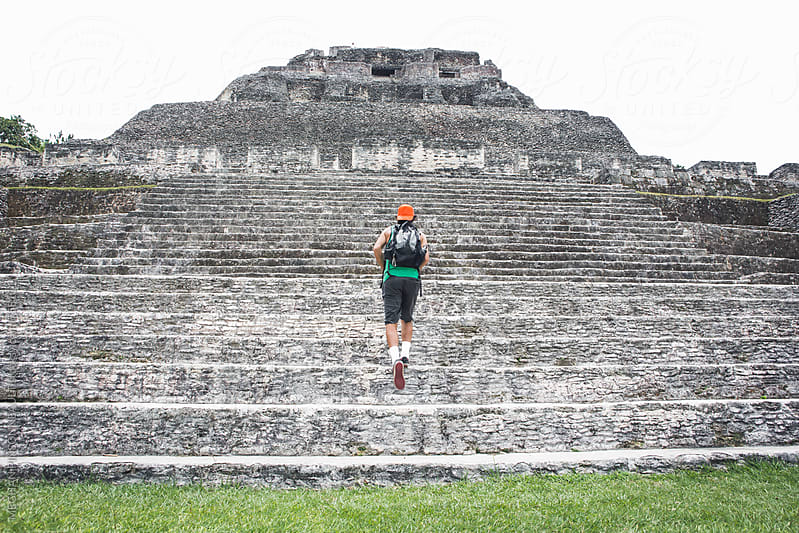 Man Climbing Ancient Mayan Steps by MEGHAN PINSONNEAULT for Stocksy United