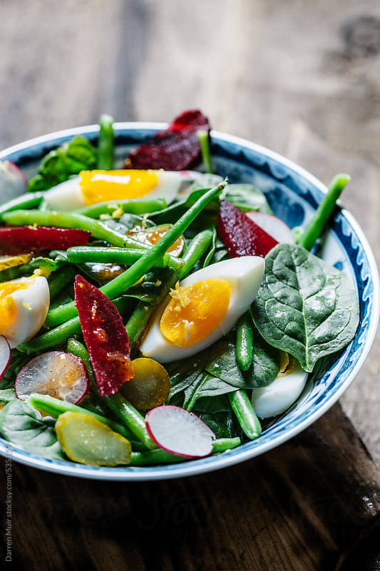 Spinach egg and french bean salad. by Darren Muir for Stocksy United