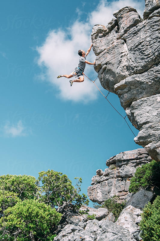 rock climber on an overhanging cliff on the mountains by Micky Wiswedel for Stocksy United