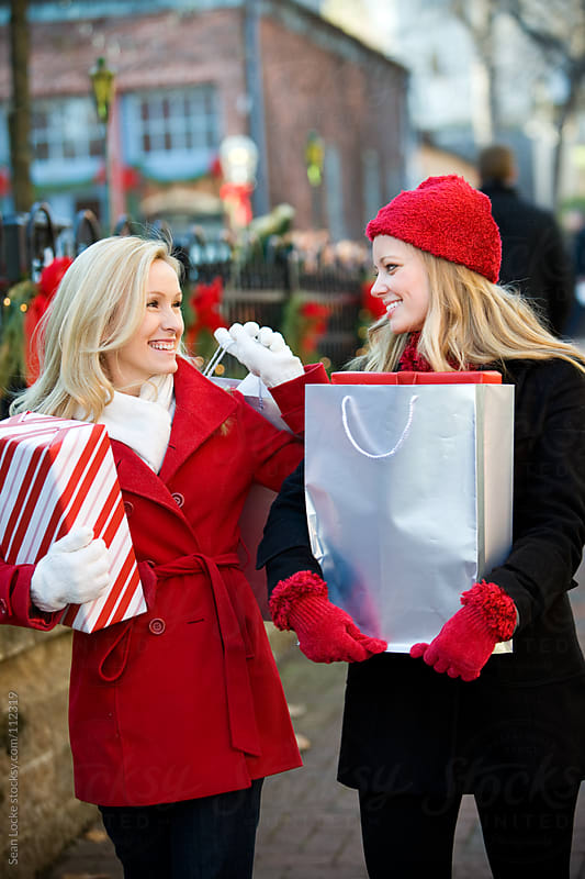 Christmas: Girls Out for a Day of Shopping by Sean Locke for Stocksy United