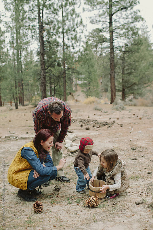 Parents looking at nature with children by Kristin Rogers Photography for Stocksy United