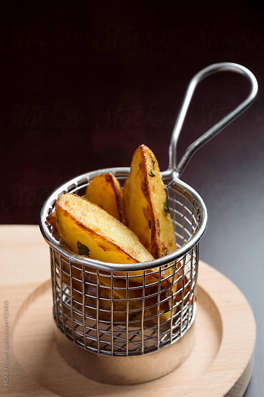 Roasted potato with herbs by Danil Nevsky for Stocksy United