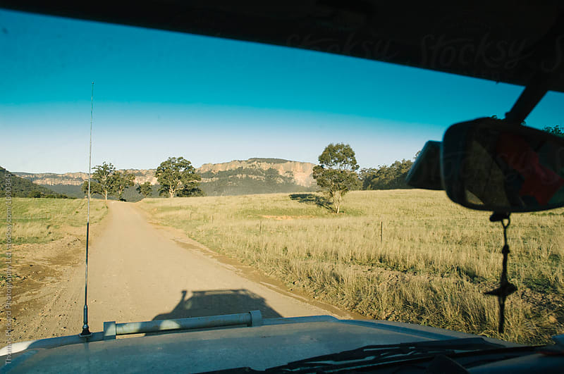 Driving down a dirt road in the Wolgan Valley, New South Wales,  by Thomas Pickard for Stocksy United
