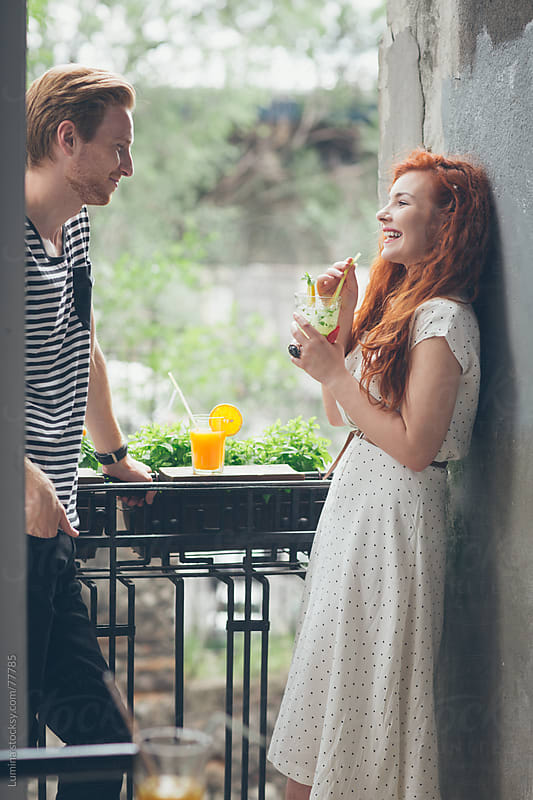 Ginger Couple Having a Drink on a Balcony by Lumina for Stocksy United
