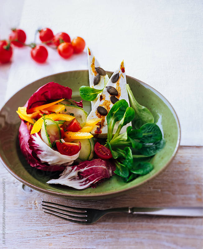Salad with feta cheese by J.R. PHOTOGRAPHY for Stocksy United