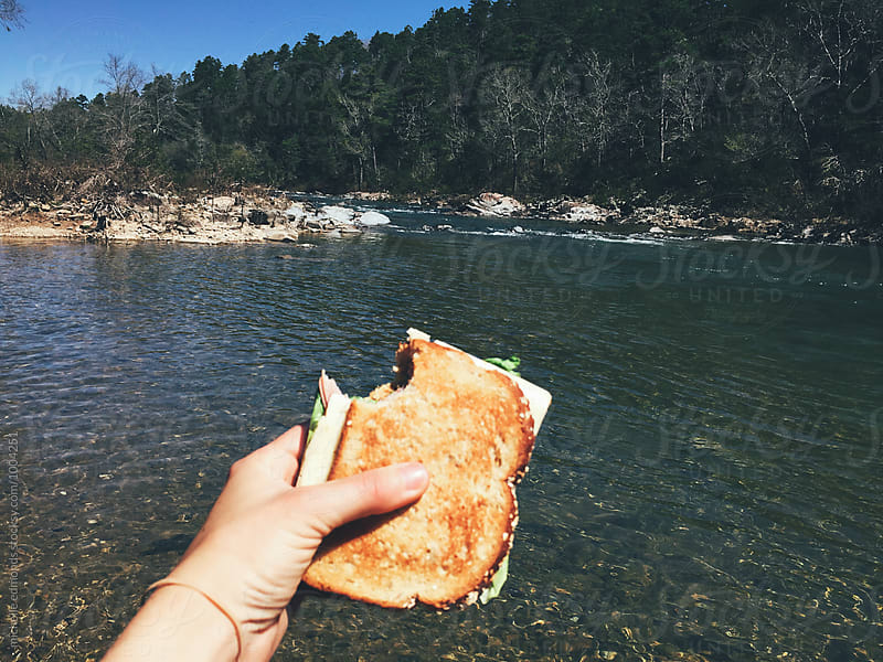 Eating a Sandwich on a River by michelle edmonds for Stocksy United