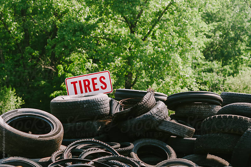 Pile of worn used automobile and bicycle tires at the dump by Deirdre Malfatto for Stocksy United