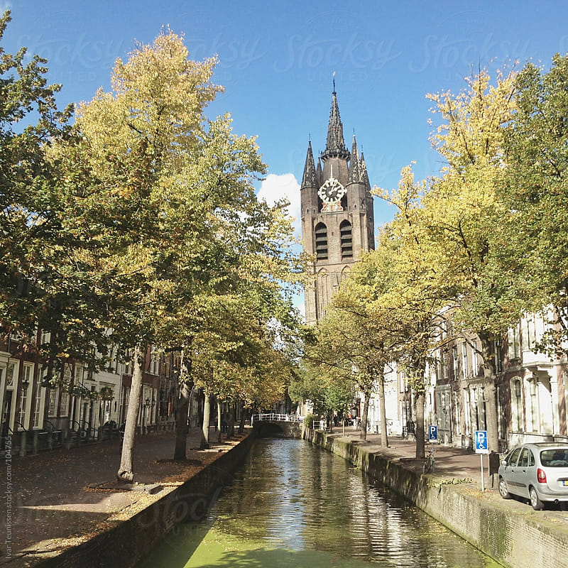 Old church and canal in Delft by Ivar Teunissen for Stocksy United