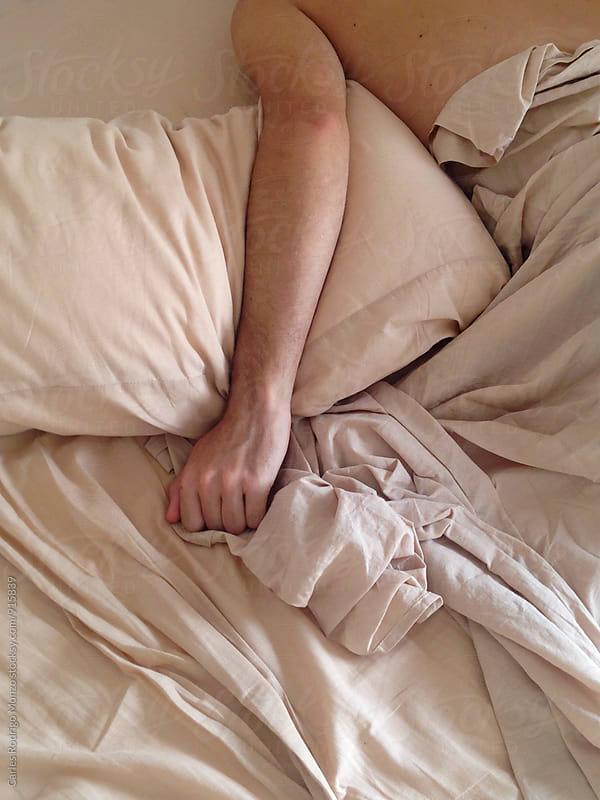 Man in bed by Carles Rodrigo Monzo for Stocksy United