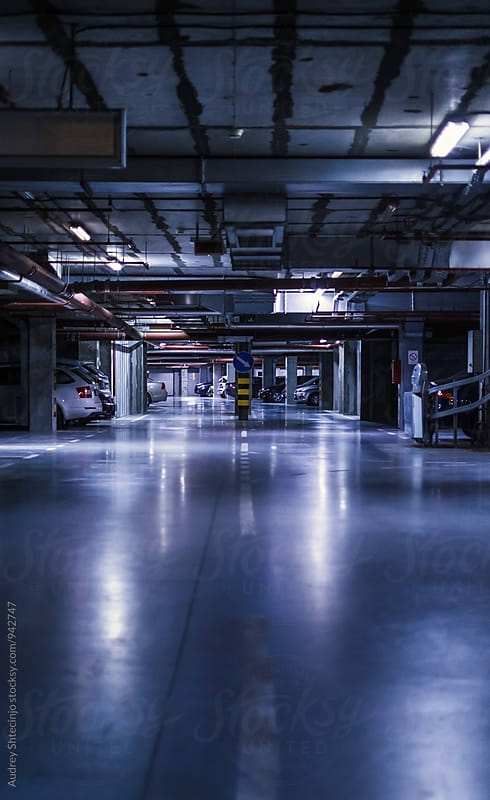 Undergorund parking/garage with neon lights -perspective by Marko Milanovic for Stocksy United