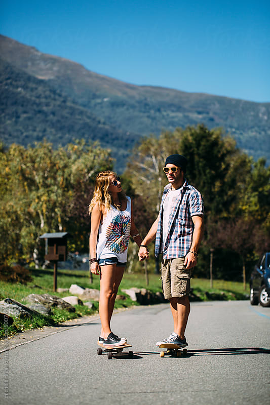 Young couple with skateboards by michela ravasio for Stocksy United