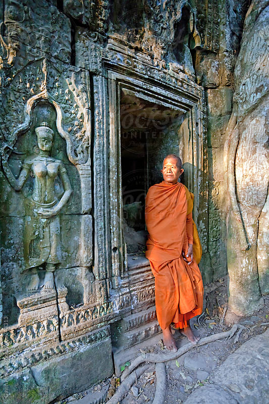 Monk in Ta Prohm Temple, Angkor, UNESCO World Heritage Site, Siem Reap, Cambodia, Indochina, Asia by Gavin Hellier for Stocksy United