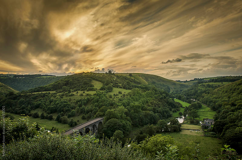 Dramatic shot of English countryside with yellow sky. by Mike Marlowe for Stocksy United