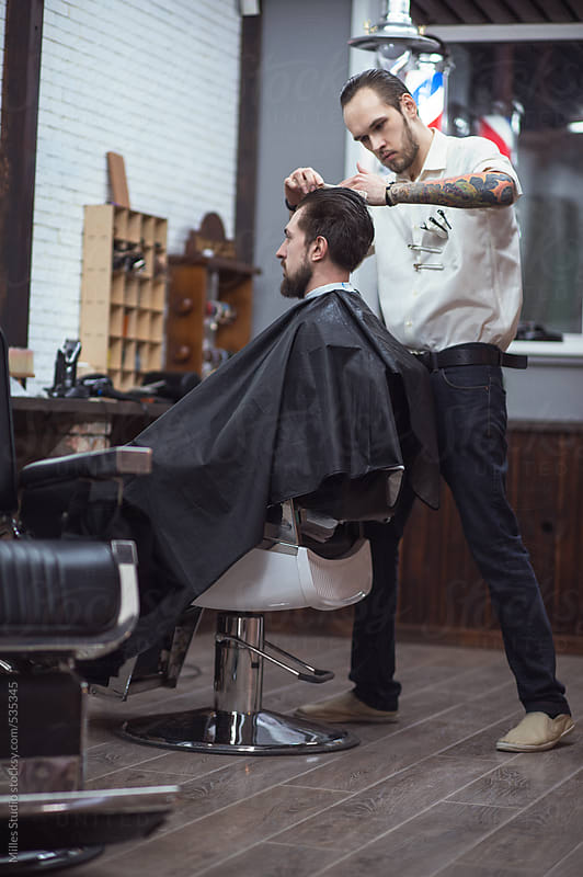 Barber fixing hair before Cutting to a Client by Milles Studio for Stocksy United
