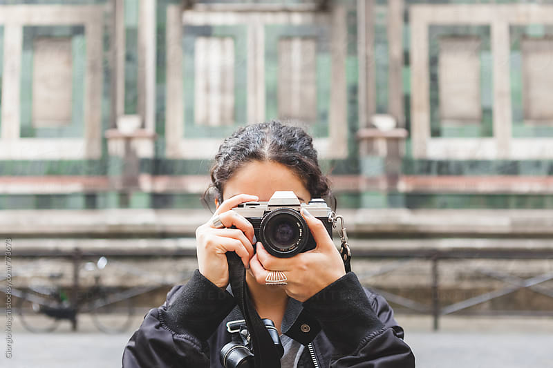 Female Photographer Taking Pictures with an Old Analog Camera by Giorgio Magini for Stocksy United