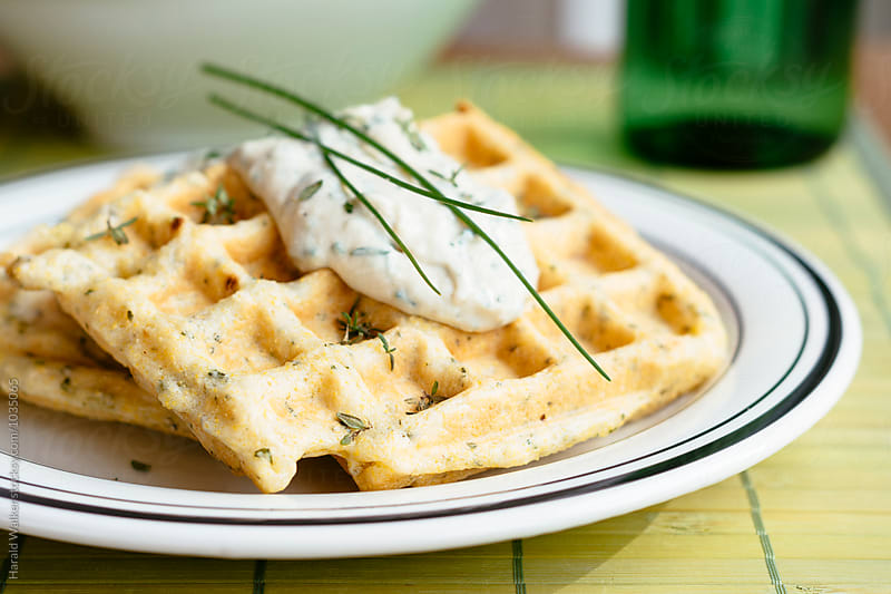 Savory waffles with herbed sauce by Harald Walker for Stocksy United