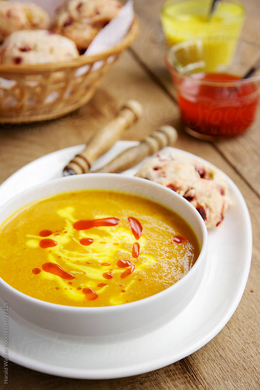 Carrot soup and biscuits by Harald Walker for Stocksy United