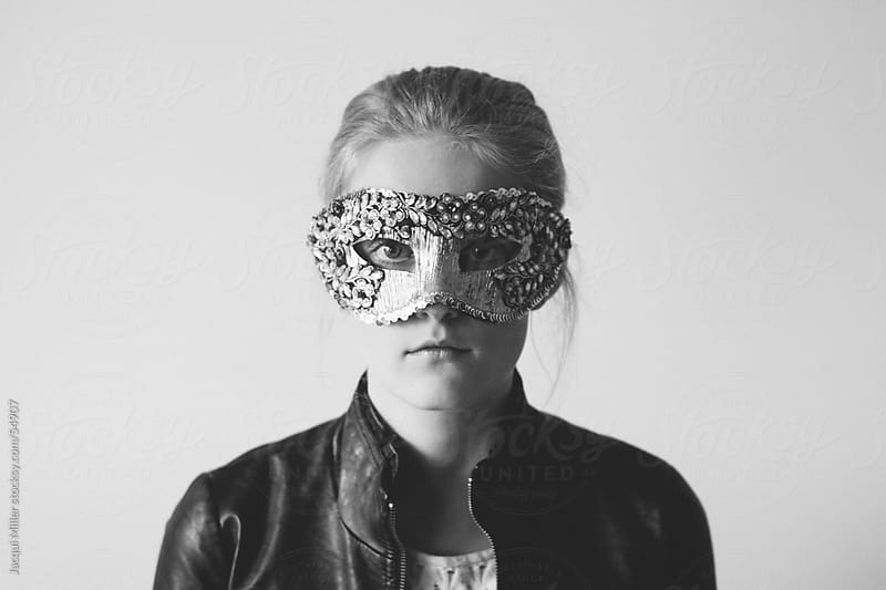 Girl wearing a mask by Jacqui Miller for Stocksy United