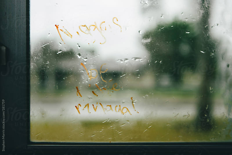Controversial graffiti on school bus window by Stephen Morris for Stocksy United