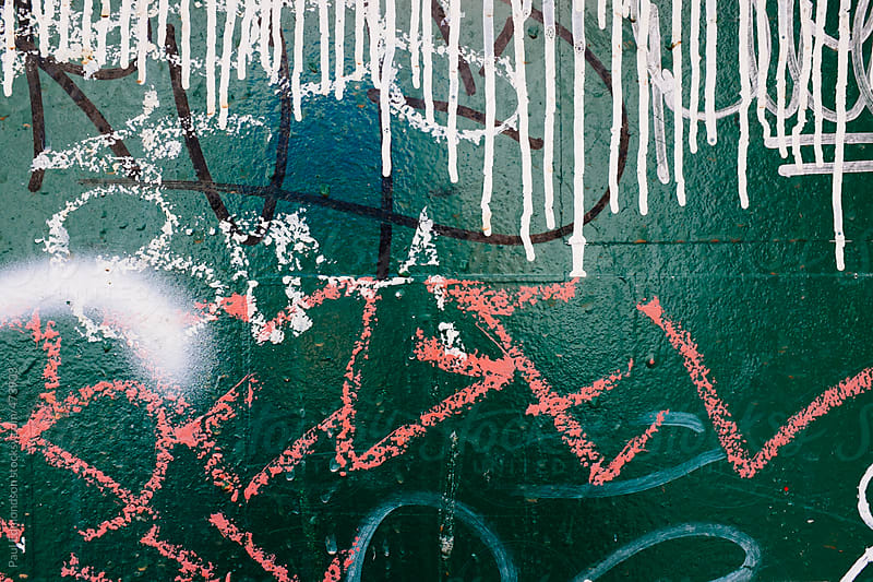 Dripping paint and graffiti on garbage canister, close up by Paul Edmondson for Stocksy United