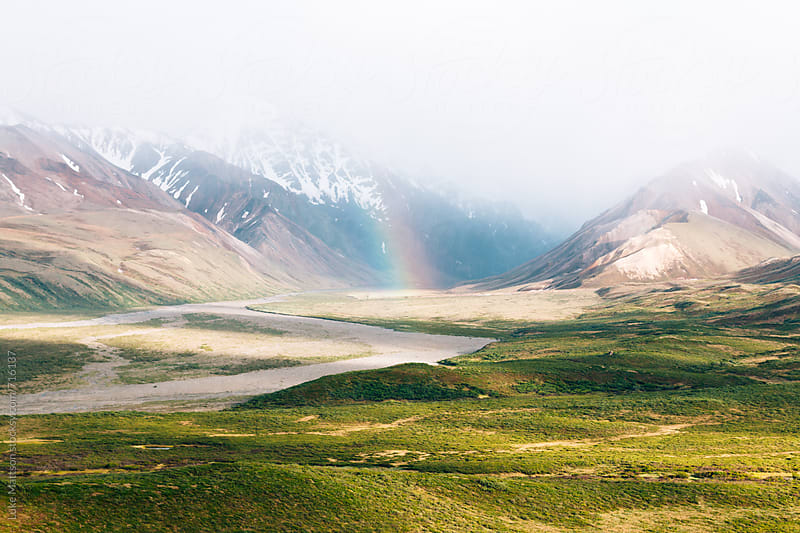 A Piece Of Rainbow In The Mountain Mist by Luke Mattson for Stocksy United