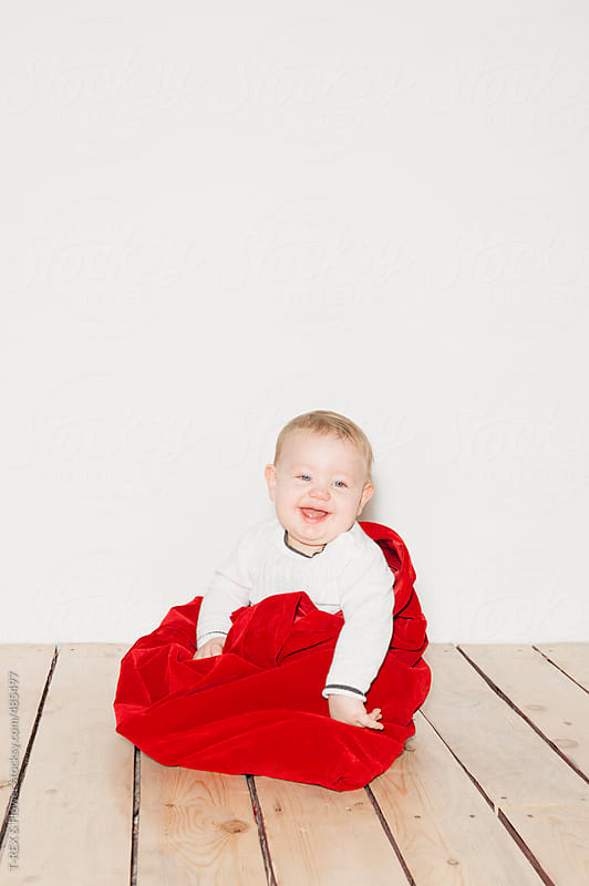 Baby boy sitting on floor at home by T-REX & Flower for Stocksy United