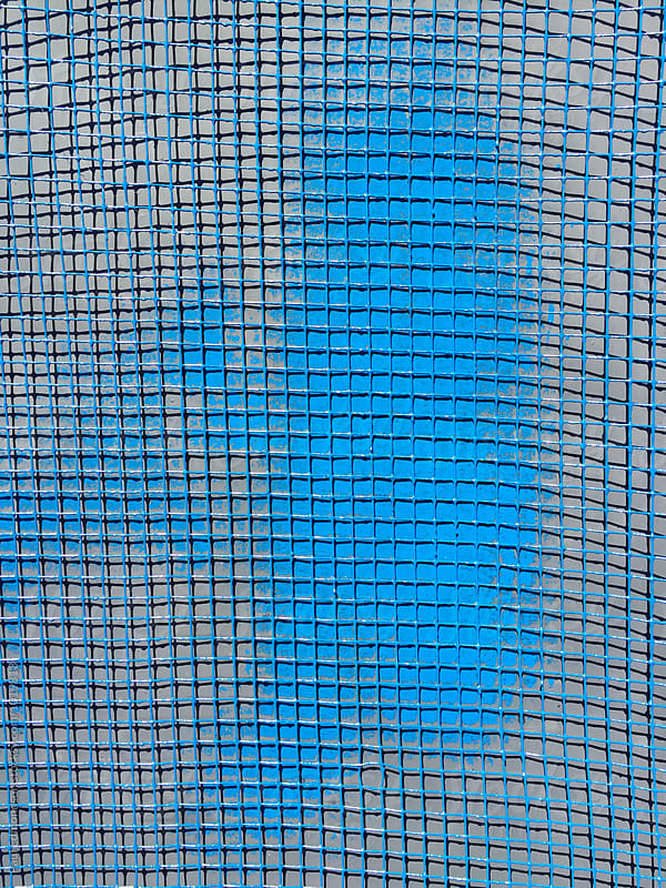 Blue graffiti paint on blue screen mesh, close up by Paul Edmondson for Stocksy United