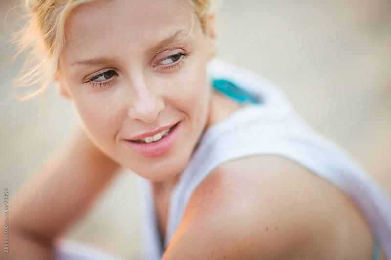 Smiling Caucasian Woman Outdoors by Lumina for Stocksy United