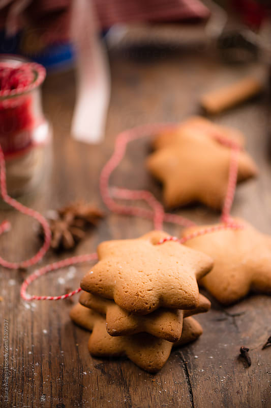 gingerbread biscuits  by Laura Adani for Stocksy United