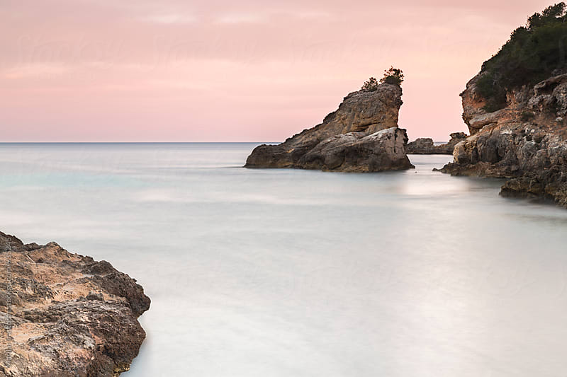 Rocks on a beach at sunset by Marilar Irastorza for Stocksy United