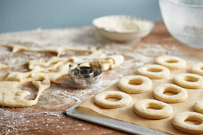 Preparing homemade donuts by Martí Sans for Stocksy United