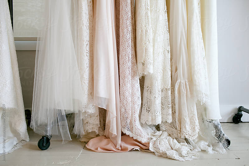 Rack of wedding dress by Jen Brister for Stocksy United