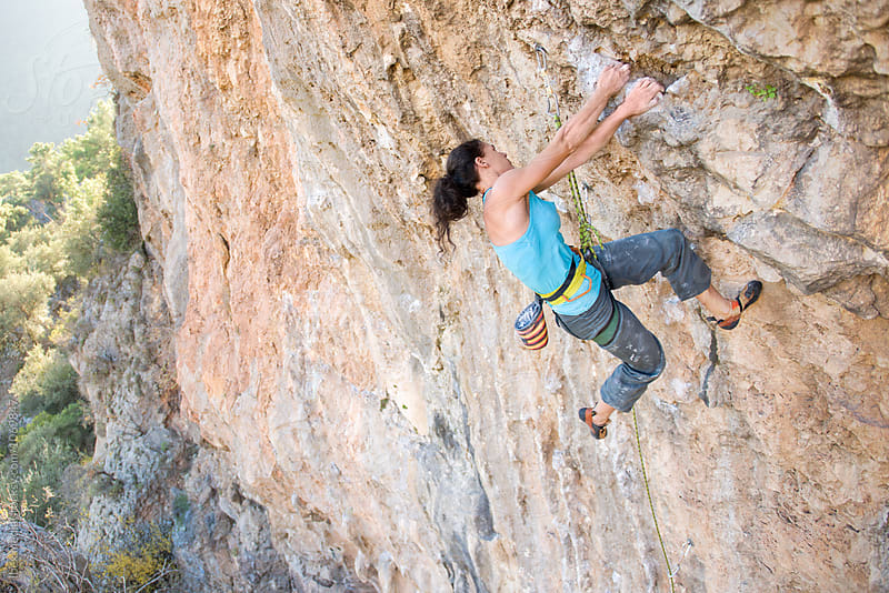Female rock climber on a difficult route  by RG&B Images for Stocksy United
