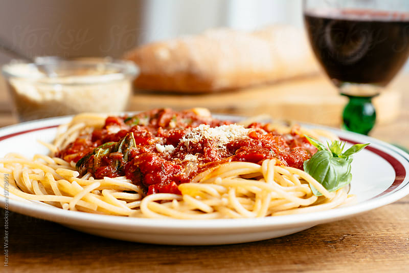 Wholewheat spaghetti with tomato sauce by Harald Walker for Stocksy United