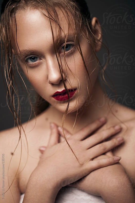 Portrait  girl with wet hair and red lips. High quality.  by T-REX & Flower for Stocksy United