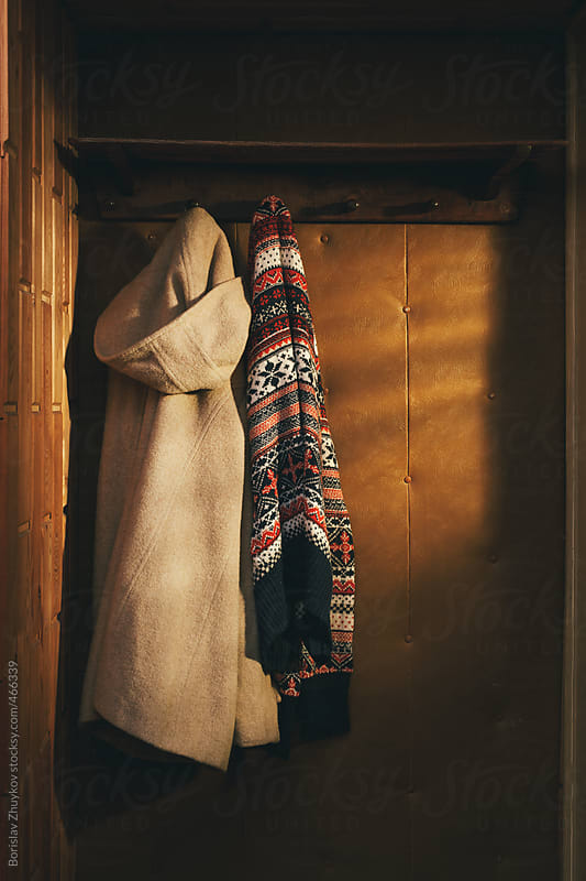 Winter Clothes Hanging From Old Wooden Wall Hook by Borislav Zhuykov for Stocksy United