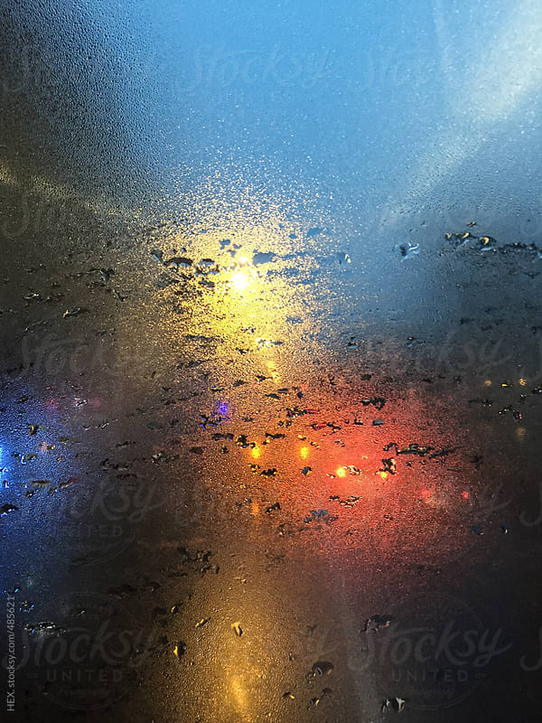 Wet Window Car in a Traffic  Jam . Background by HEX. for Stocksy United