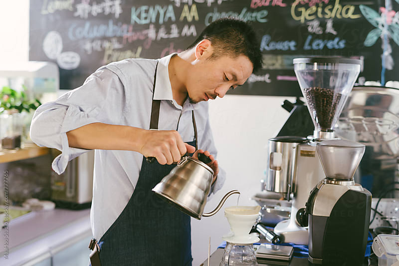 Young man preparing coffee by MaaHoo Studio for Stocksy United