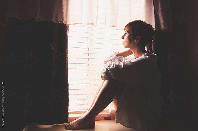 Sitting Woman Looking Out Window by Tamara Pruessner for Stocksy United