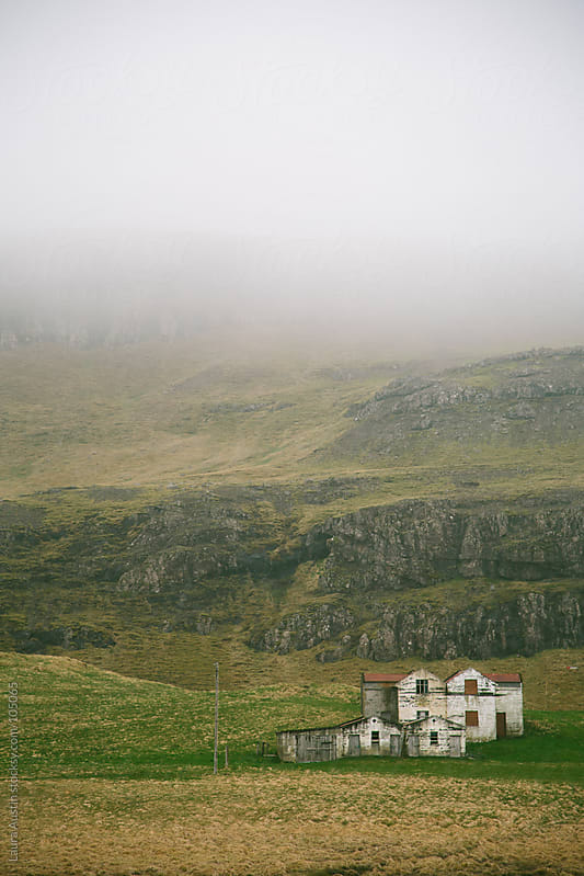 Abandoned House Along Foggy Hills by Laura Austin for Stocksy United