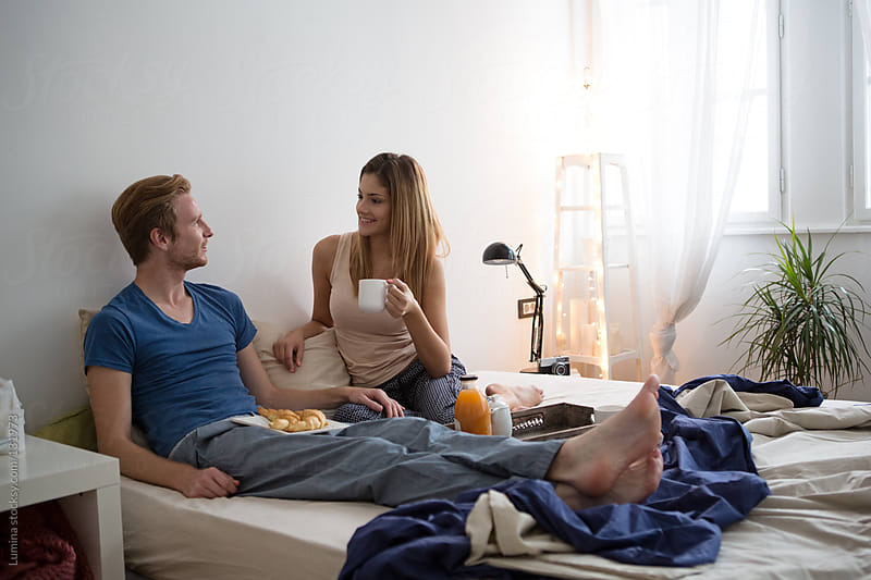 Couple Having Breakfast in Bed by Lumina for Stocksy United
