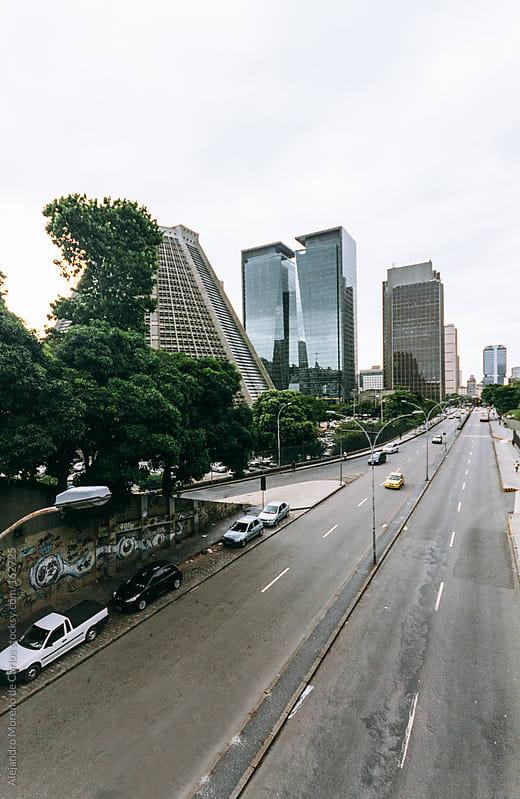 Road in a city with buildings. Rio de Janeiro, Brazil  by Alejandro Moreno de Carlos for Stocksy United