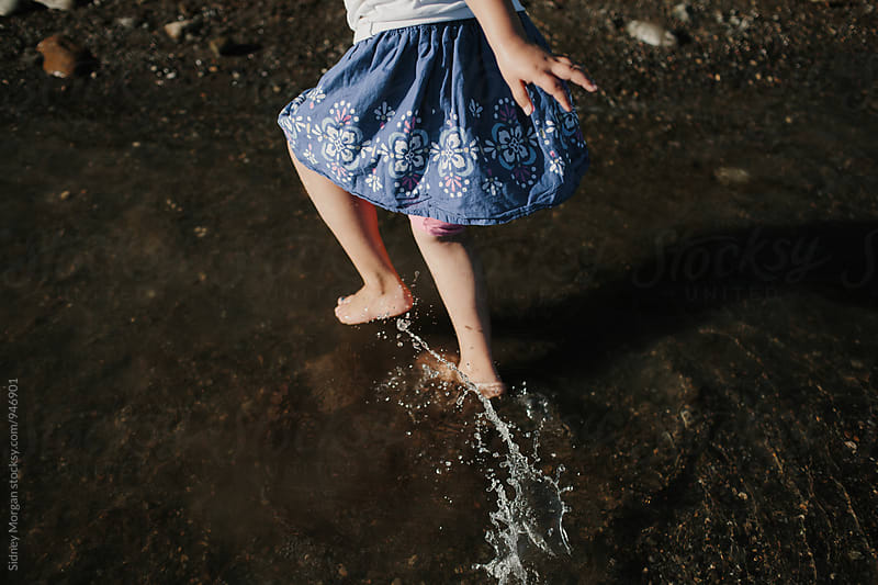 Girl Running in Water by Sidney Morgan for Stocksy United